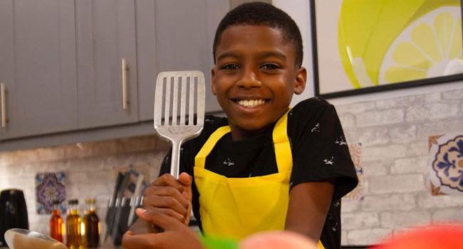 Omari McQueen in his kitchen