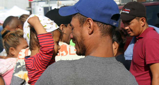 Father and child at the border